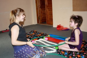 Britta teaches one of IRODA's children with circus therapy.