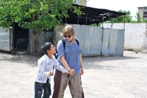 Britta walks hand-in-hand with a child who is part of Tajikistan's only autism-advocacy group.