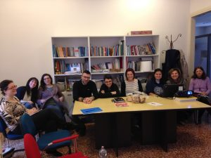 Alessandra Testa (Bologna, Italy, Spring 2016)-Testa (third from right) at Caritas, a Roman Catholic nonprofit organization, learning about how the Roman Catholic Church was responding to immigration in Bologna